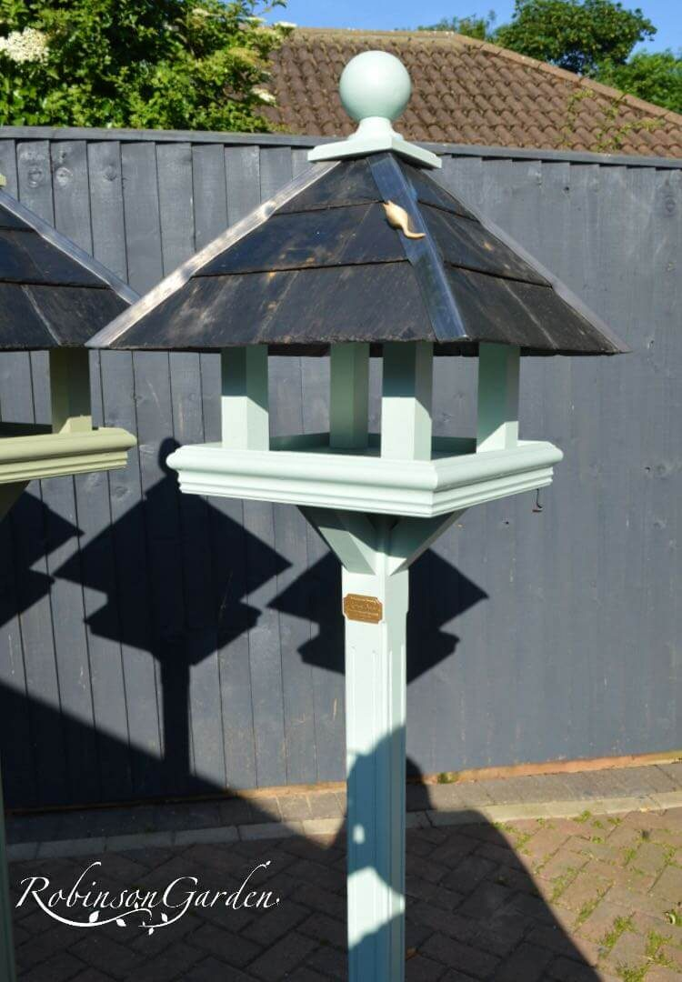 Bespoke bird table design with a slate roof hand painted in Lincolnshire, England, UK using Farrow & Ball exterior eggshell paint. Uniquely crafted using sustainable FSC certified timber / wood. This bird table and feeder is anti squirrel that doesn't require anchoring pegs or to be attached to a fence. The bird table design is different to Argos, B&M, ALDI, homebase, dobbies, gardman, home bargains, pets at home, B&Q, b & q, M&S, Robert dyas, rspb, ikea, john lewis, QVC or any other garden centre. We are an online only store and we are not on the high street. We also have outlet shops across etsy and ebay UK. Our design plan, dimensions and height are suitable for small birds and is freestanding and a perfect bird table gift. Hooks provided to allow bird feeders to be hung from the bespoke bird feeders and table. Visit out gallery to see all the bird table images. Other options include bird table on pole or bird table on spike. Willow bird table on a tree stump option. Bird table / bird feeder delivered ready assembled. Perfect bird table for your garden.